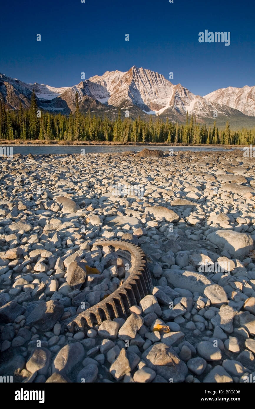 Trash left on the bank of the Athabasca River with Mount Fryatt in the distance, Jasper National Park, Alberta, - Stock Image