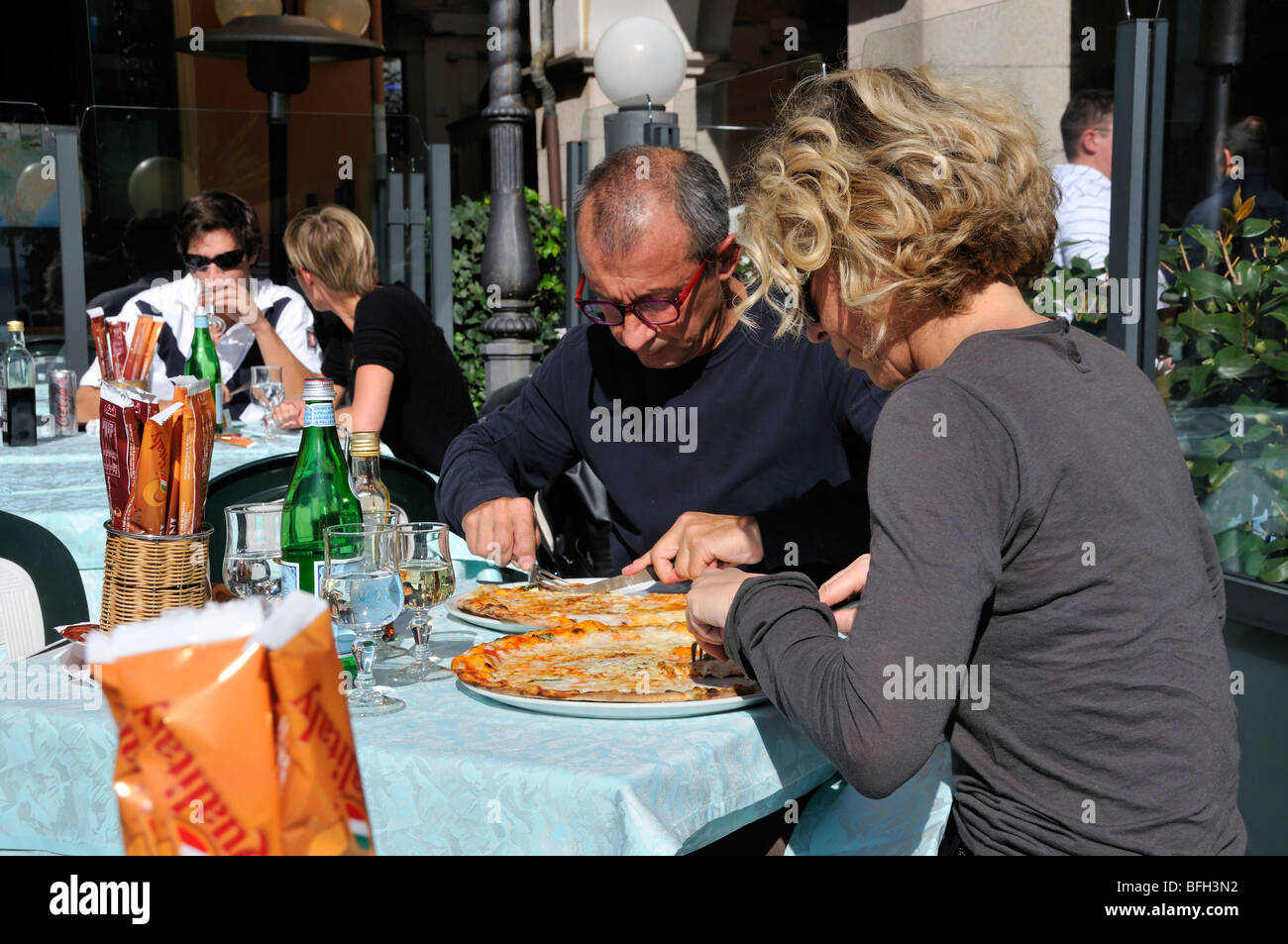 A caucasian couple eating pizza at pizzeria, Italy, Europe, Stock Photo