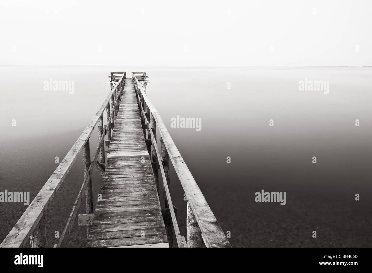 Wooden Pier on Lake Winnipeg.  Rebuilt every spring due to the Lake freezing solid.  Matlock, Manitoba, Canada. - Stock Image