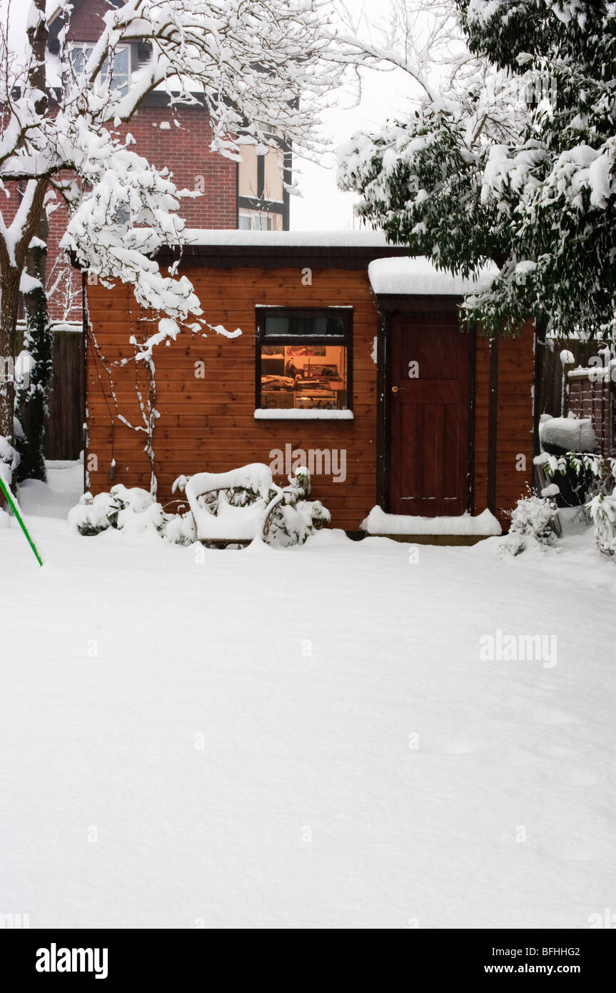 office garden shed. Uk, England, Surrey, Garden Shed Office Snow