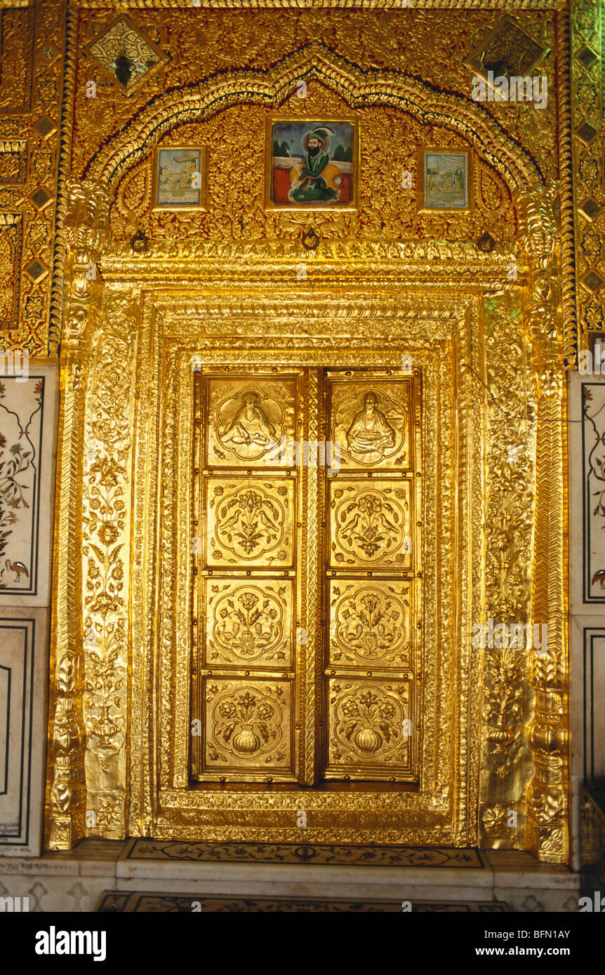 Richly painted wall gold plate embossed door and doorframe of Gurudwara of Sachkhand Sahib ; Nanded ; Maharashtra - Stock Image