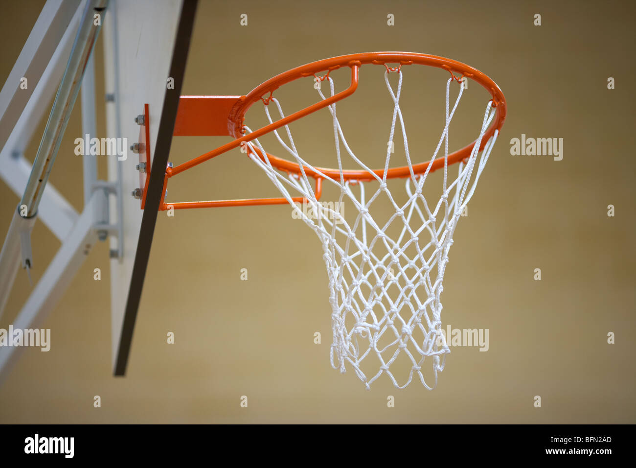 basketball net and frame in a school gym sports hall low angle selective focus - Stock Image