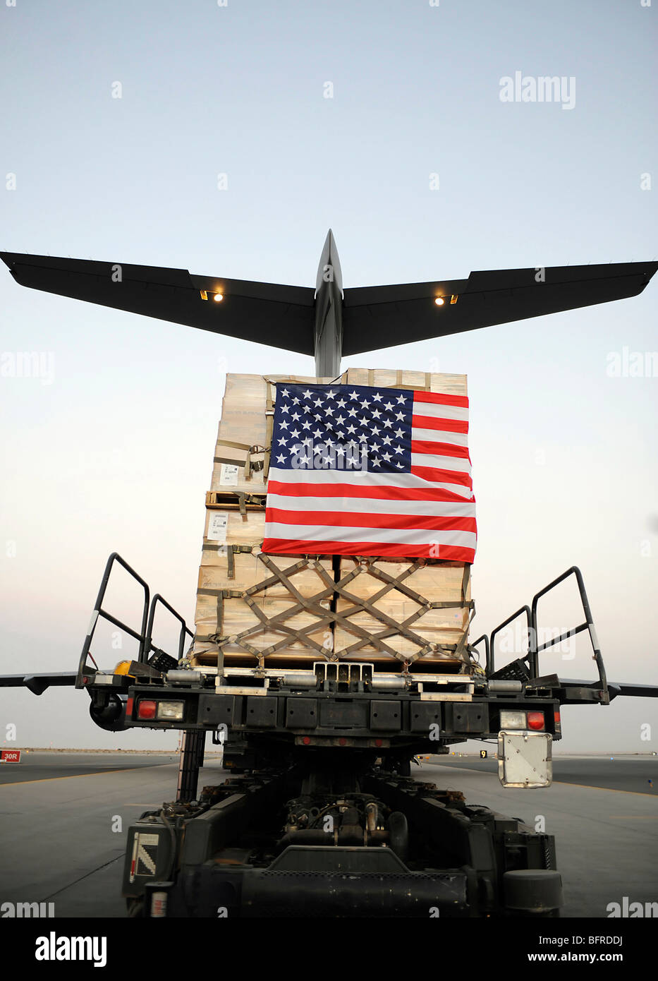 A pallet containing humanitarian relief supplies. - Stock Image
