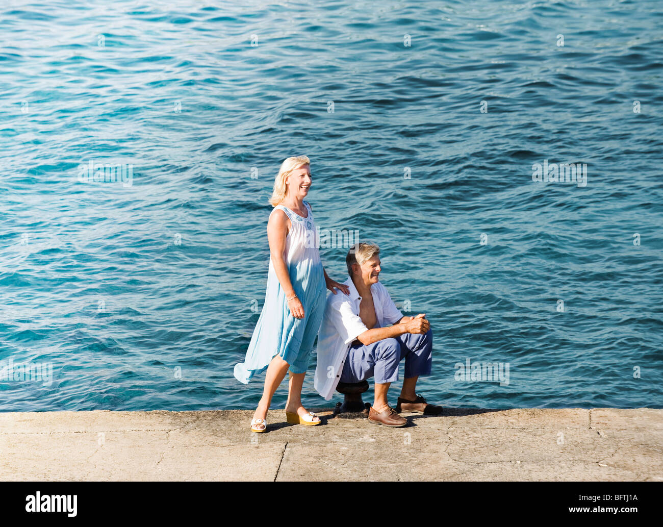 A senior couple on the quay side - Stock Image