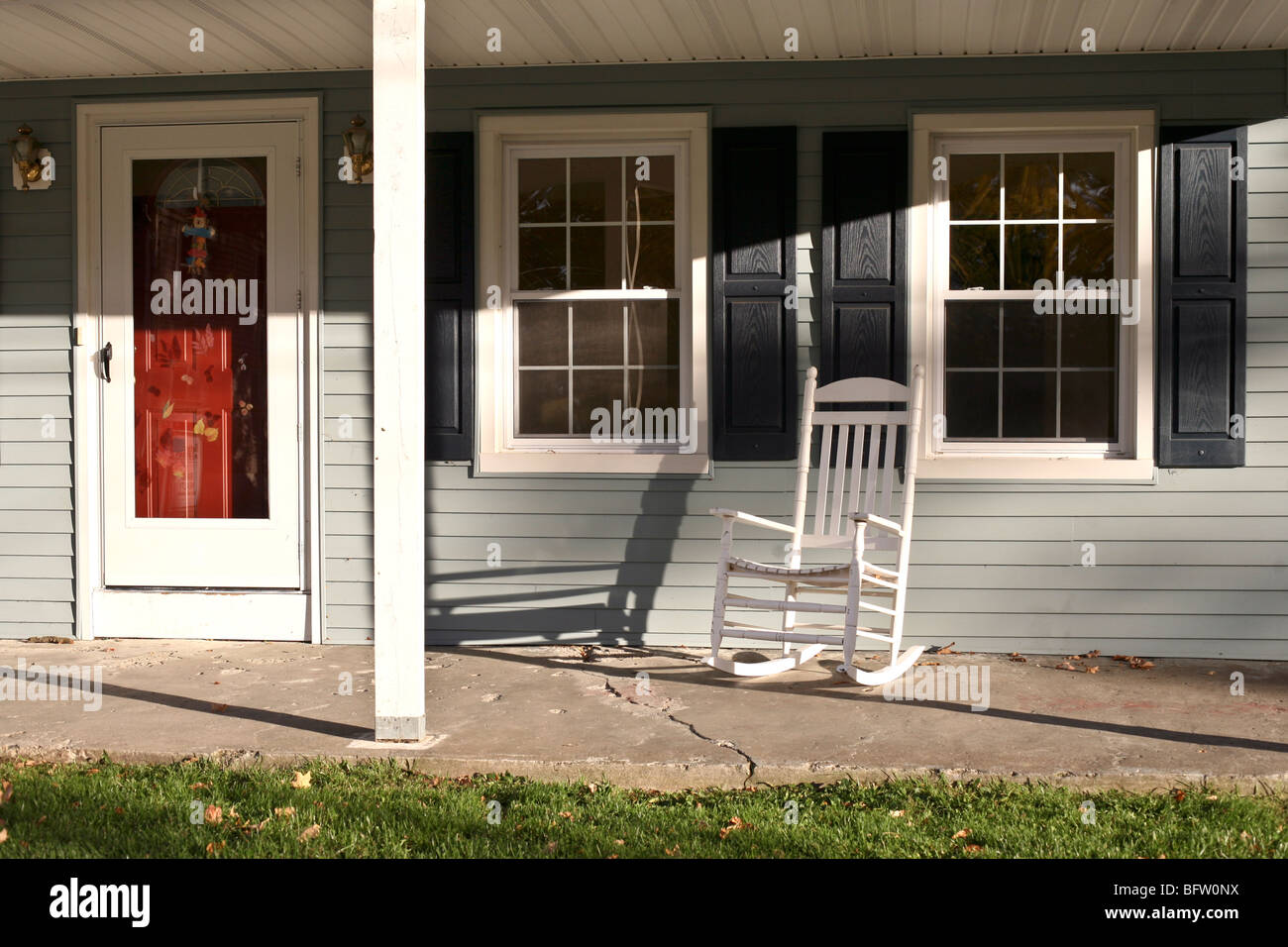 Red Entry Door U0026 Charming Front Porch With White Wood Rocking Chair Old  Gray Clapboard House On Autumn Day Montgomery New York
