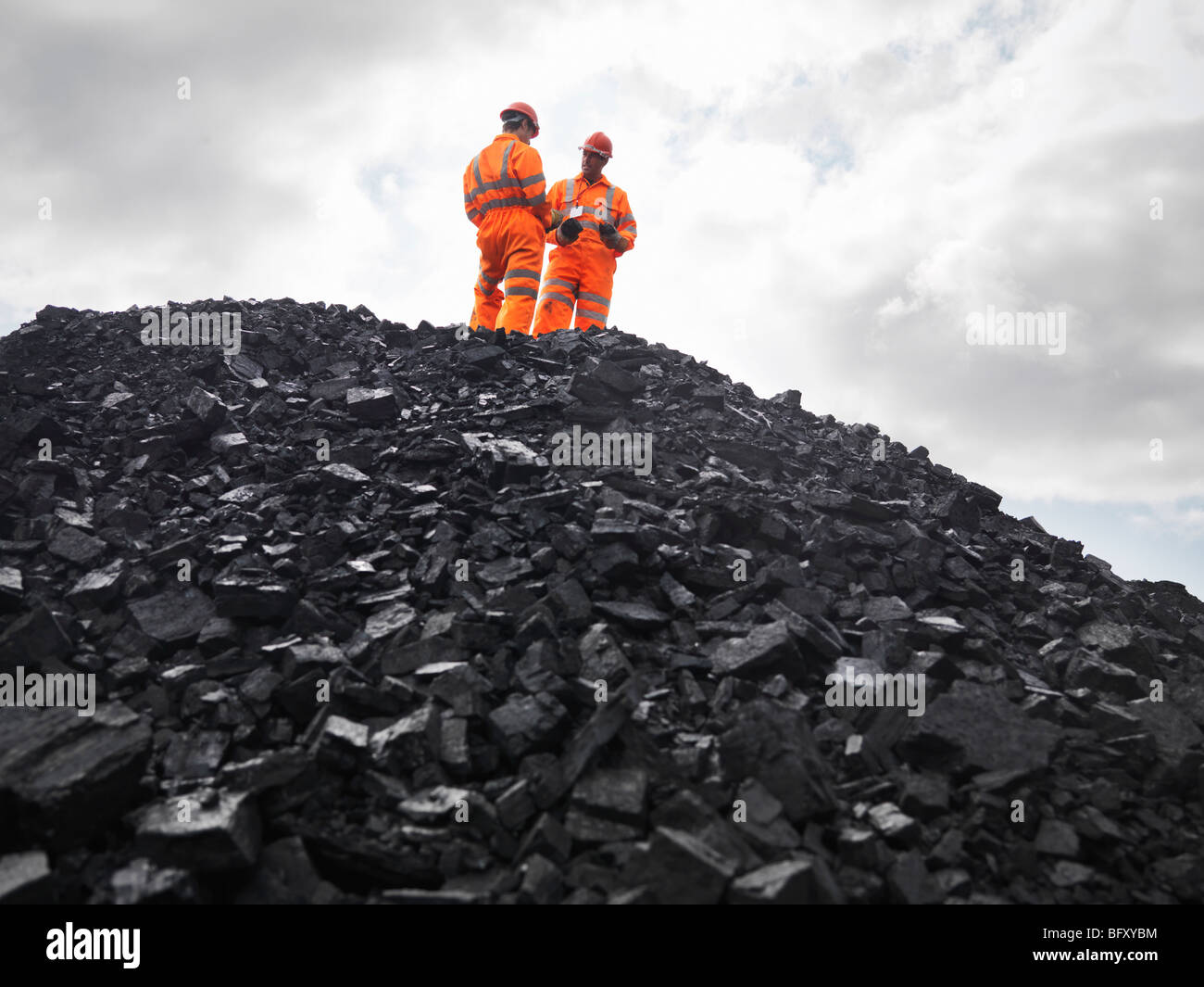 Coal Miners On Pile Of Coal - Stock Image