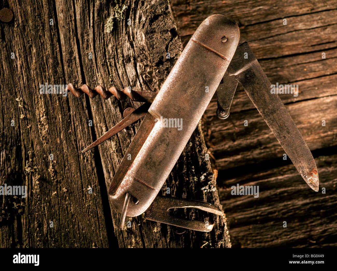 Rusty pocket knife - Stock Image
