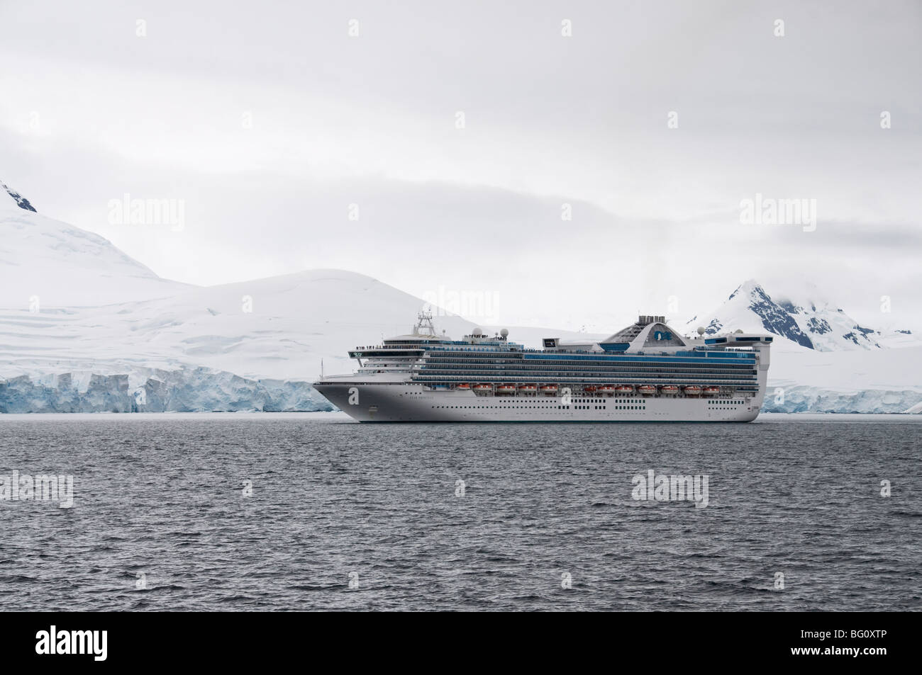 Ship sailing in the waters around the Antarctic Peninsula, Antarctica, Polar Regions - Stock Image