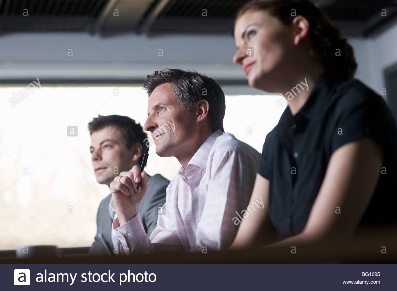 Business partners looking forwards - Stock Image