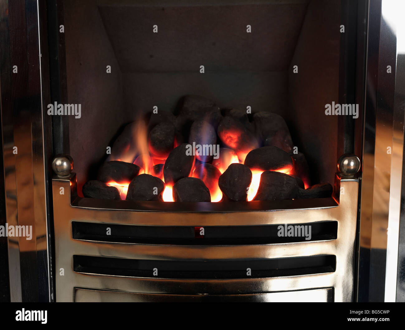 A coal effect gas fire. - Stock Image