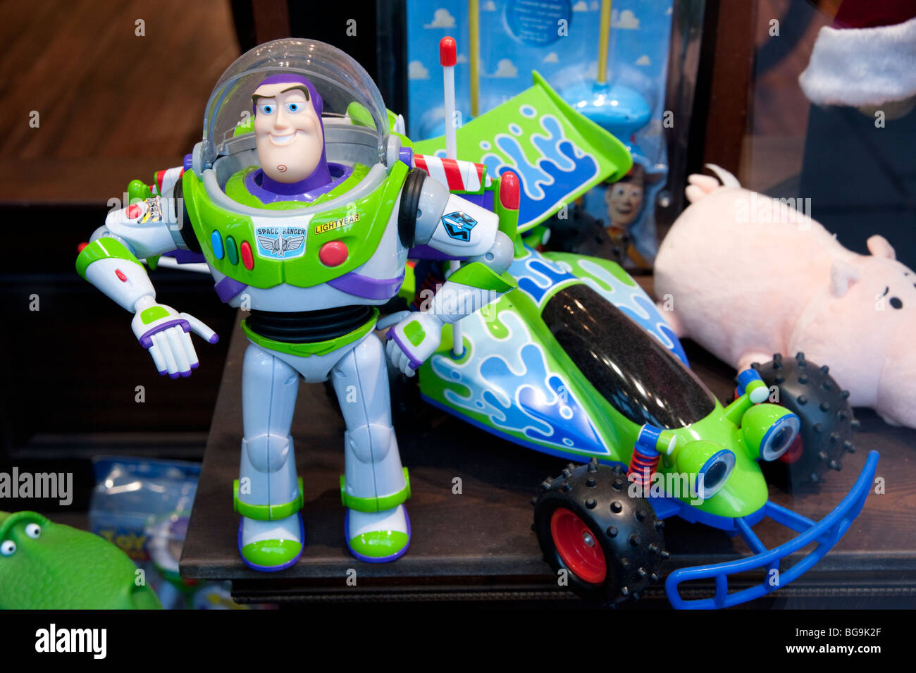Buzz Lightyear toys in shop window, England, Britain, UK - Stock Image