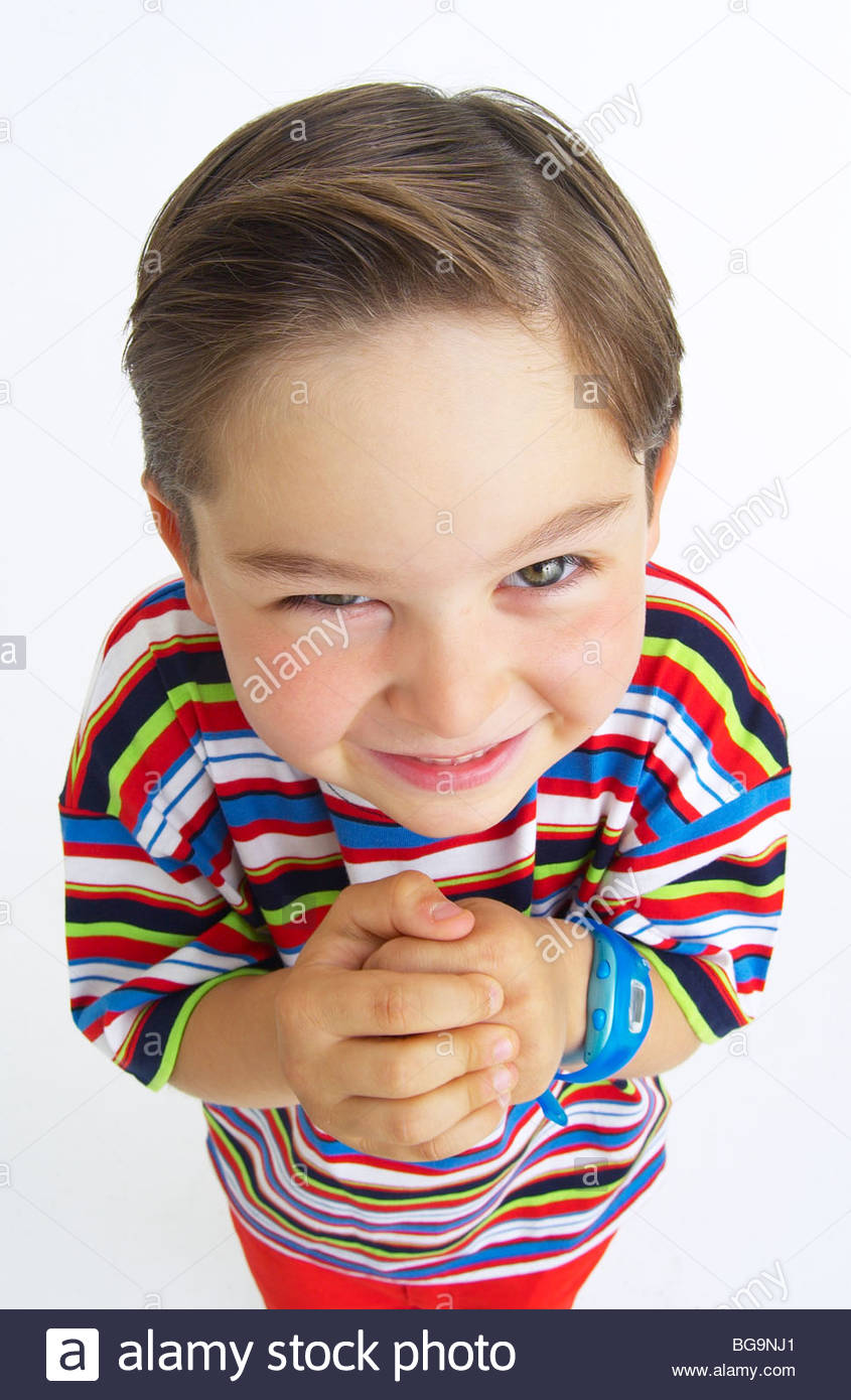 A cunning boy rubbing his hands together - Stock Image