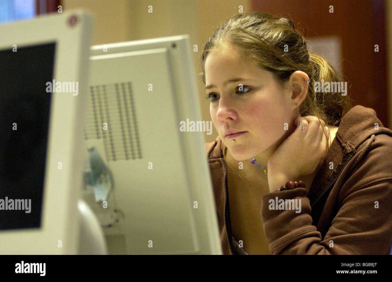 Royalty free photograph of girl college student on computer researching London UK - Stock Image