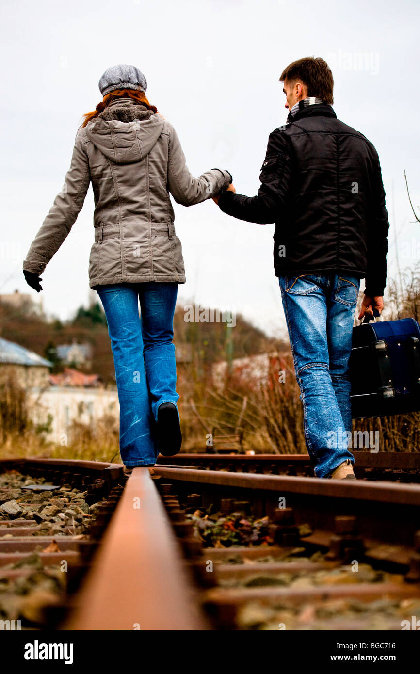 Couple on rail track - Stock Image