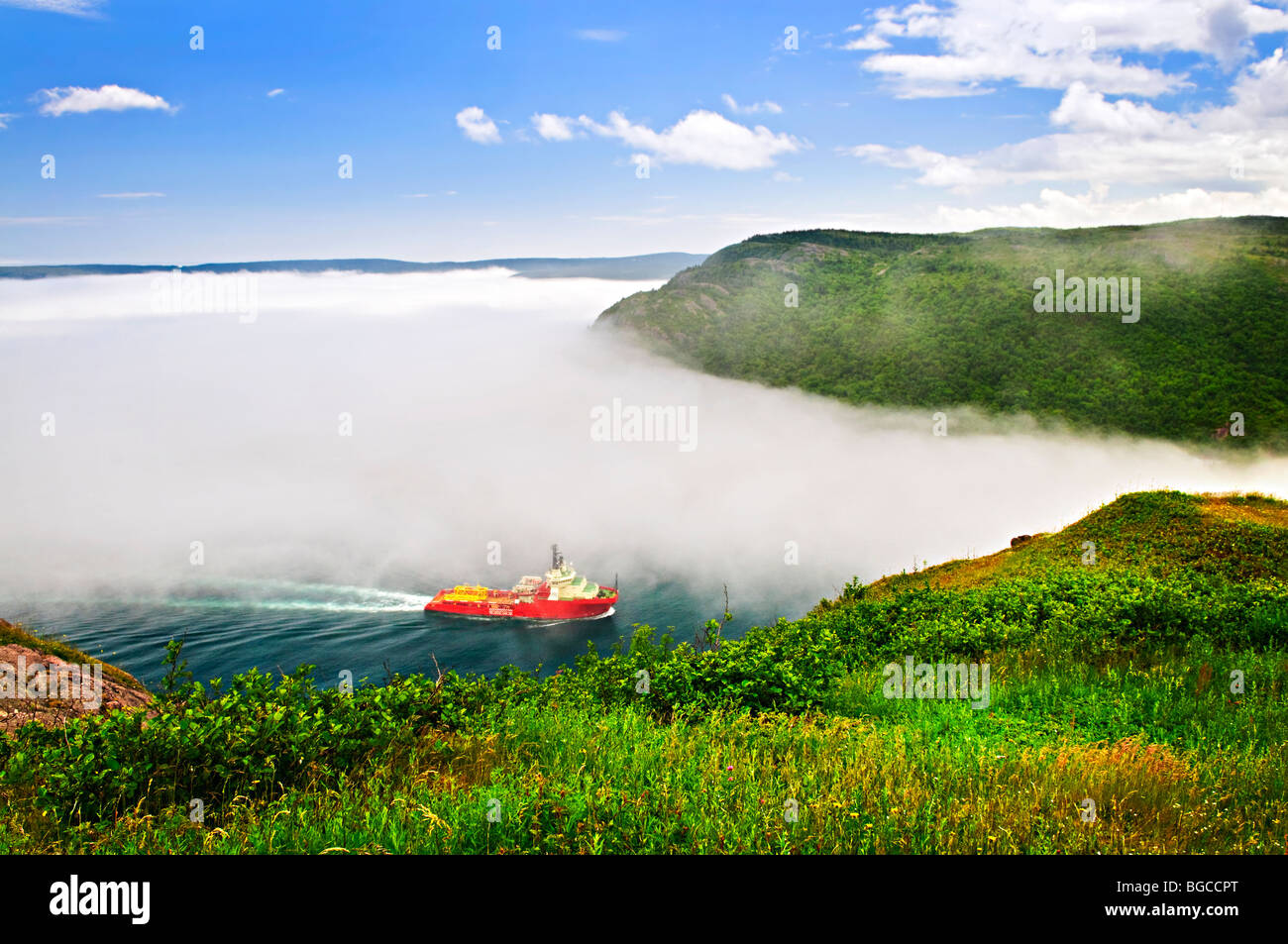 Ship entering the Narrows of St John's harbor from Signal Hill in Newfoundland Canada - Stock Image