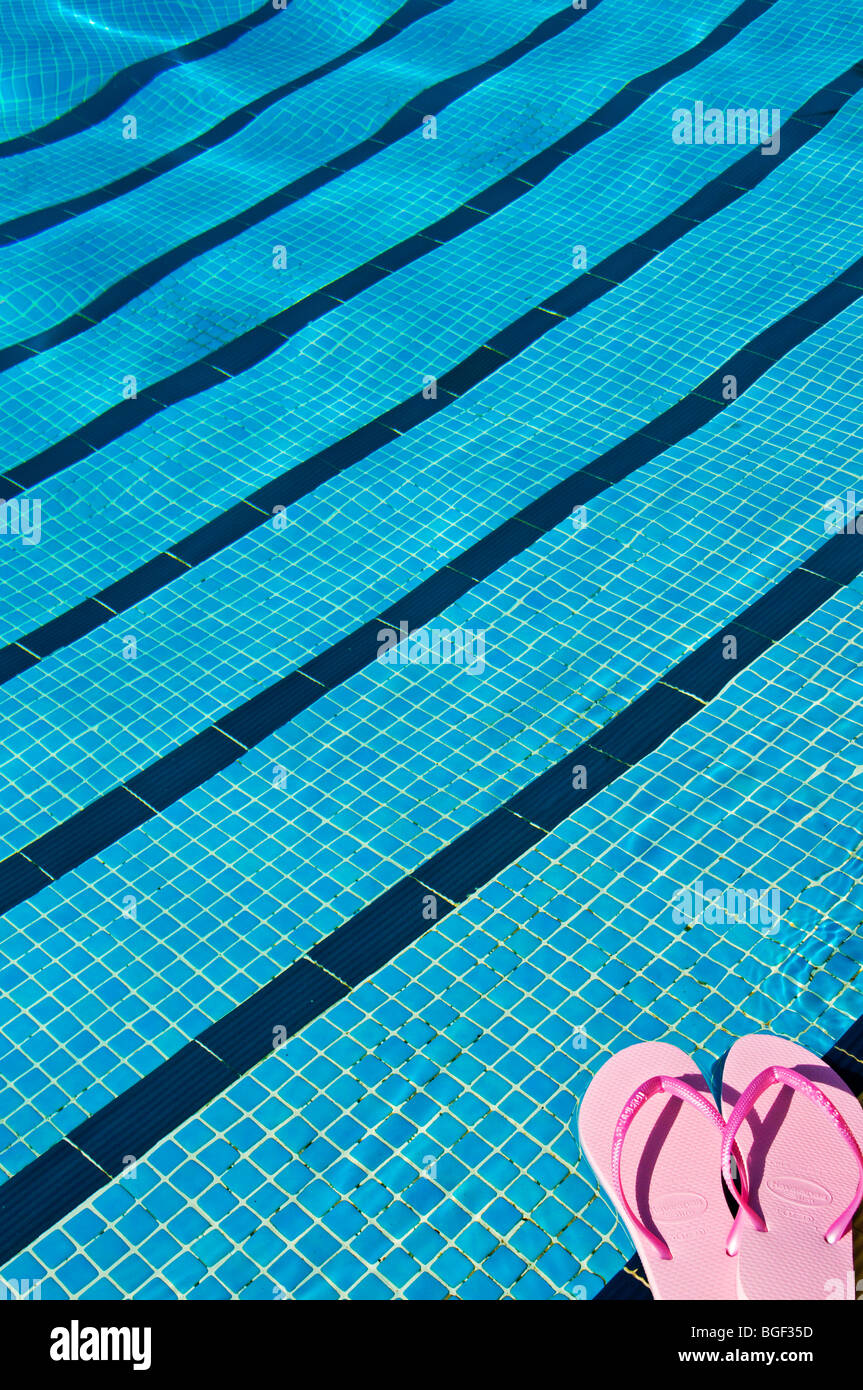 Sandals in front of a pool - Stock Image