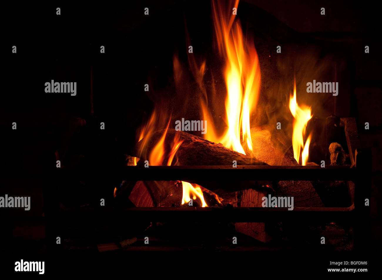 Hearth and Home - a real log fire. - Stock Image