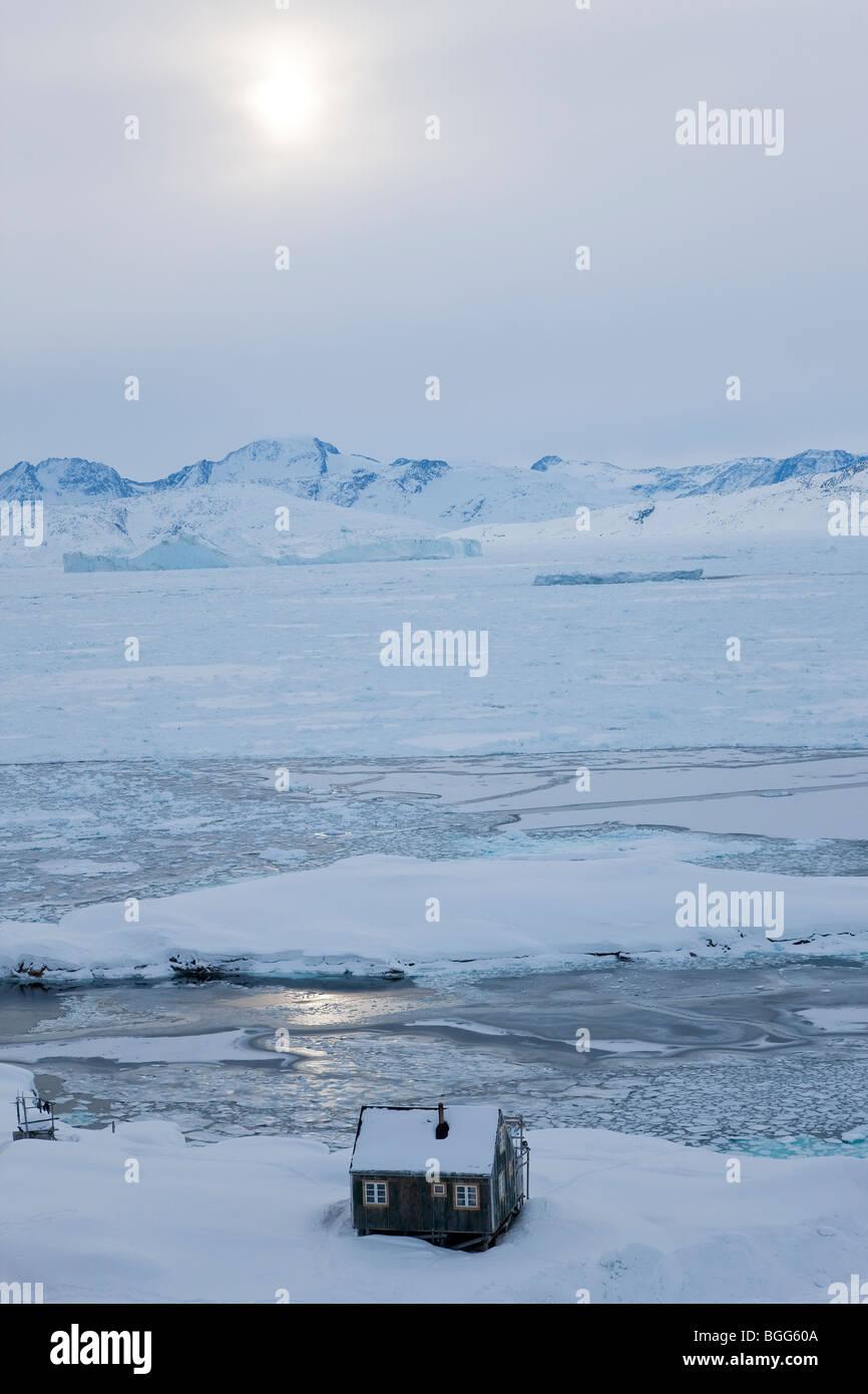 House in snow, Tiniteqilaq in winter, E. Greenland - Stock Image