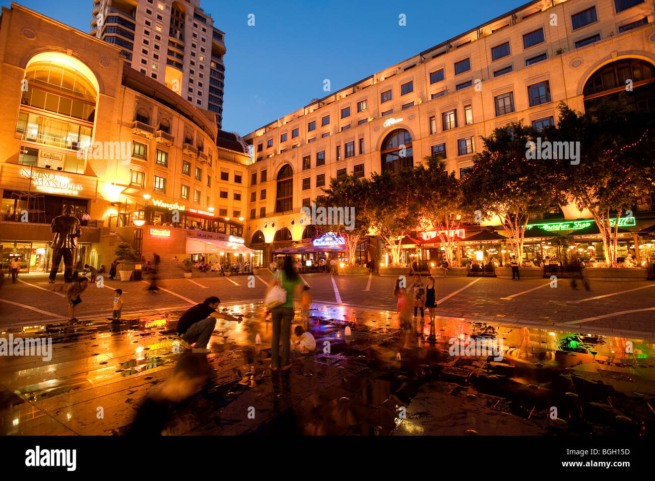 Nelson Mandela Square in the evening. Sandton, Johannesburg, South Africa - Stock Image