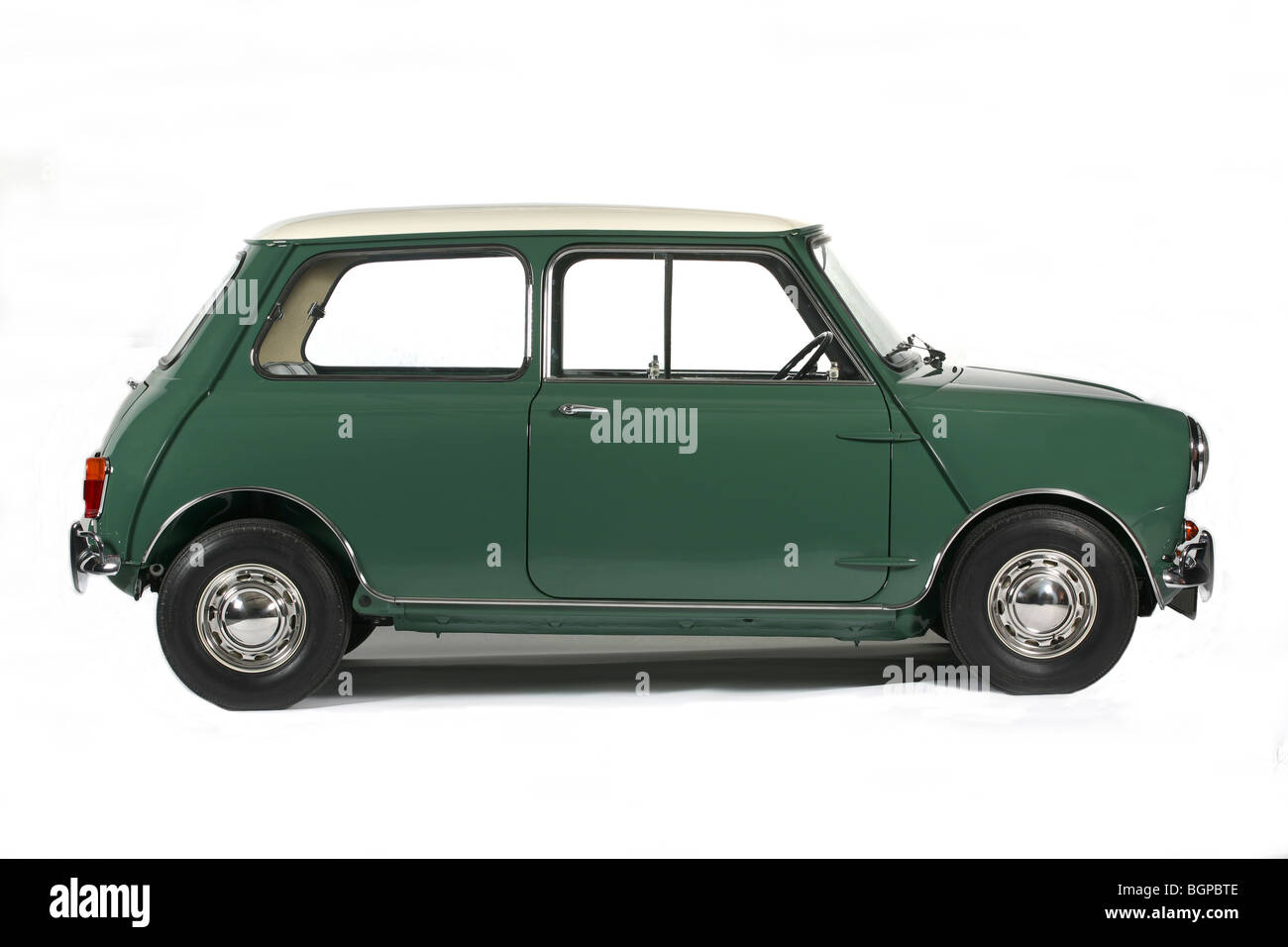 1960 green Mini Mk1 in profile photographed in the studio on a white background, designed by Sir Alec Issigonis - Stock Image