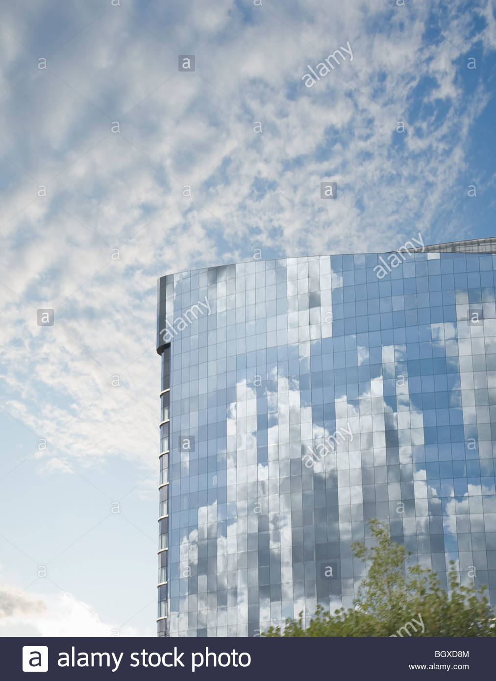 Clouds reflected in building - Stock Image