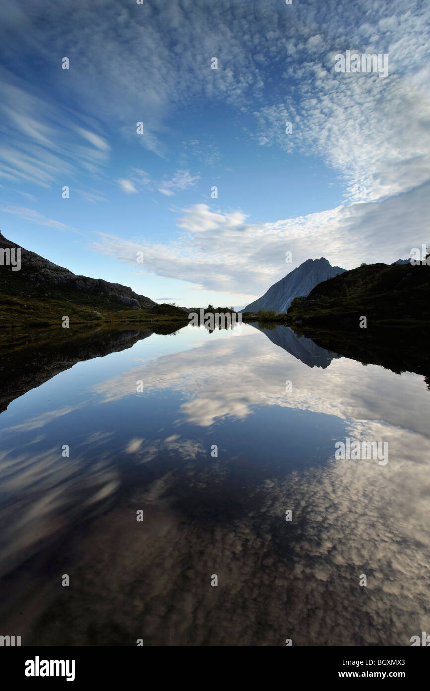 The sky reflecting in a small lake, creating a mirror image. Lofoten, North Norway - Stock Image