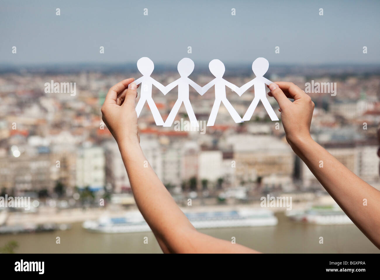 Arms cut-out paper people - Stock Image