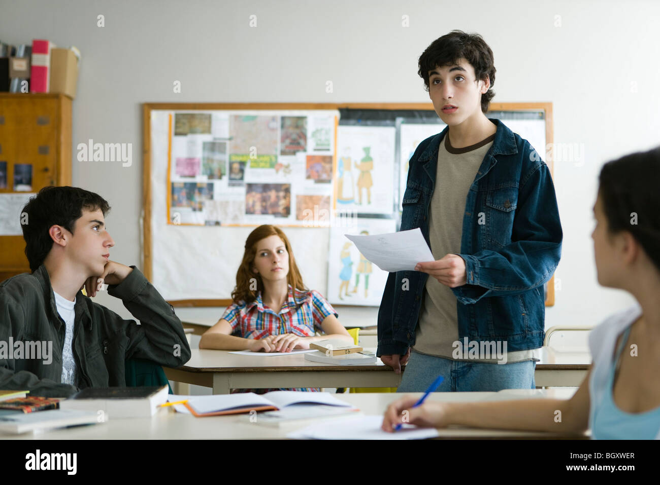 high school student giving presentation in class stock photo
