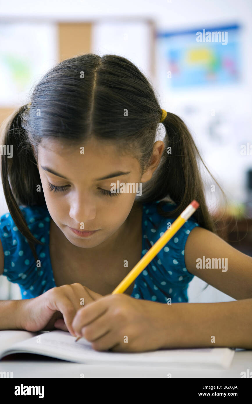 Female elementary school student in class - Stock Image