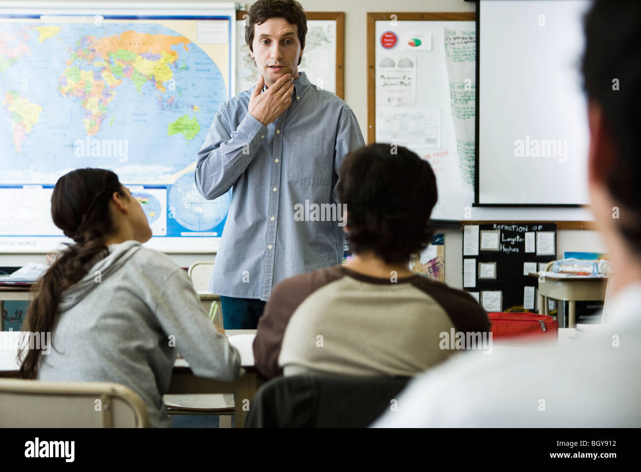 Teacher listening to student's question - Stock Image