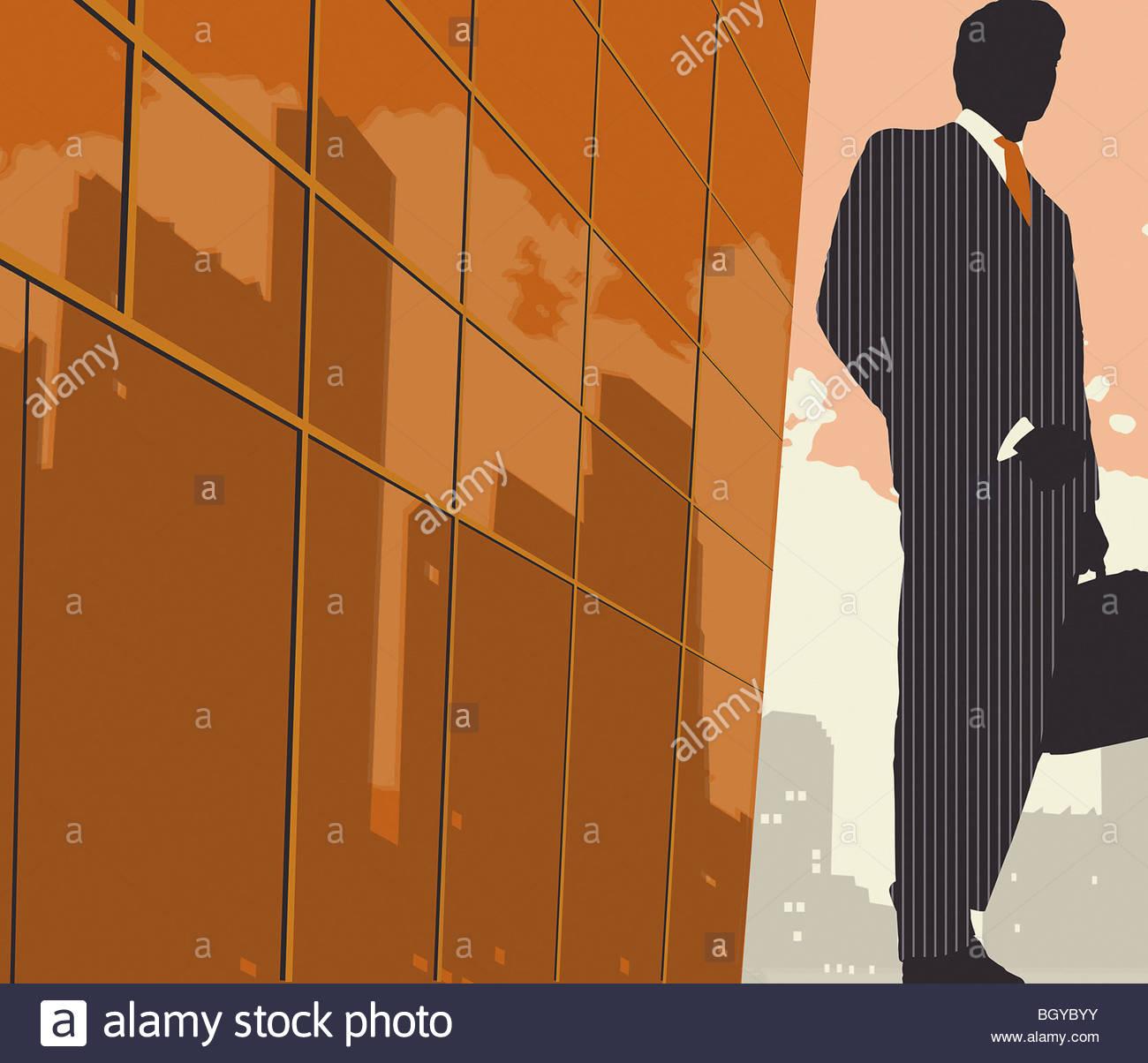 Businessman on sidewalk with briefcase - Stock Image