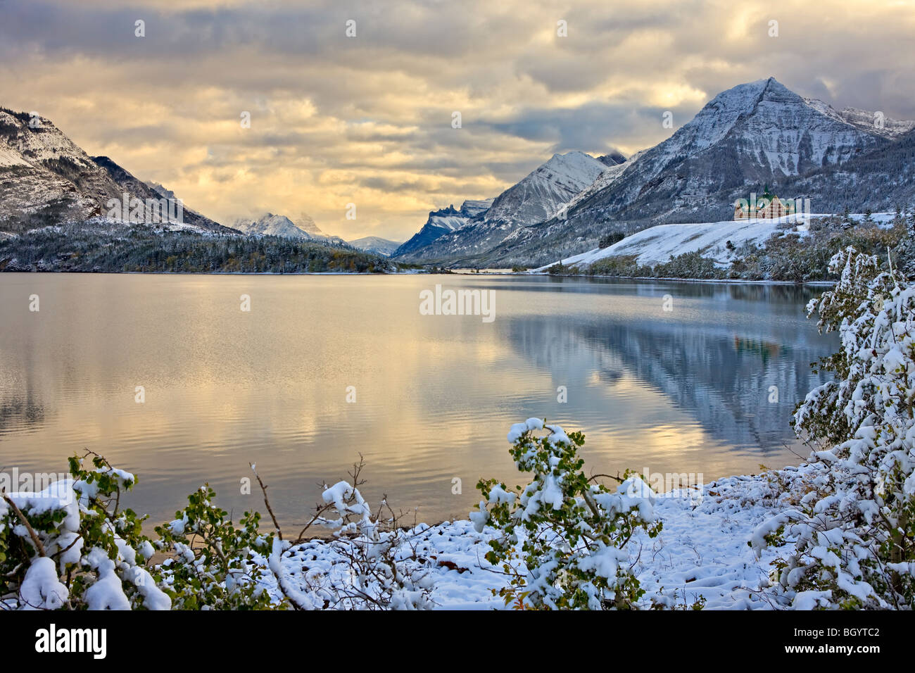 Prince of Wales Hotel overlooking Middle Waterton Lake after the first snowfall of winter, Waterton Lakes National - Stock Image