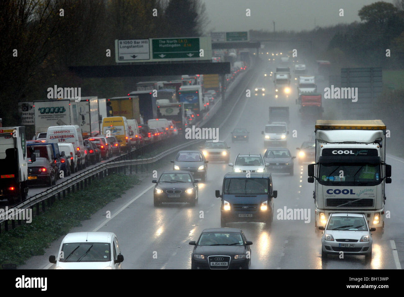 CARS ON MOTORWAY IN THE RAIN Stock Photo