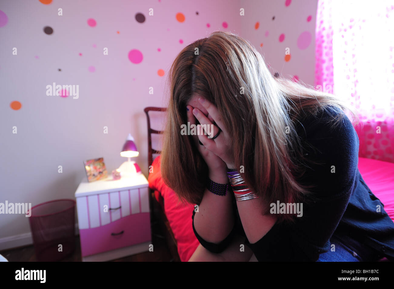14-year-old-girl-teenager-with-depression-upset-in-her-bedroom-mr-BH1B7C.jpg