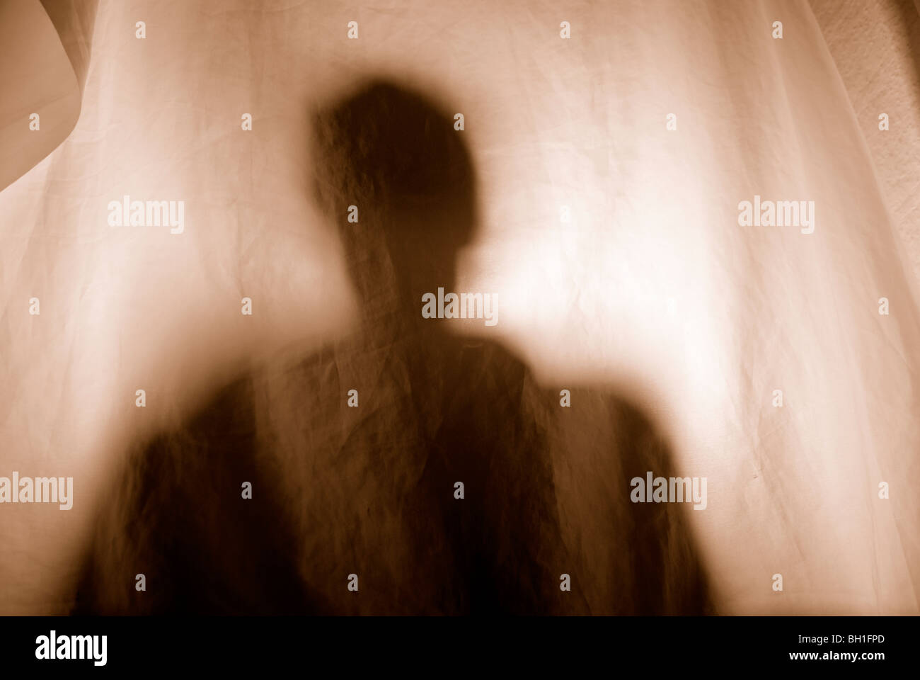 OMINOUS SILHOUETTE - Stock Image