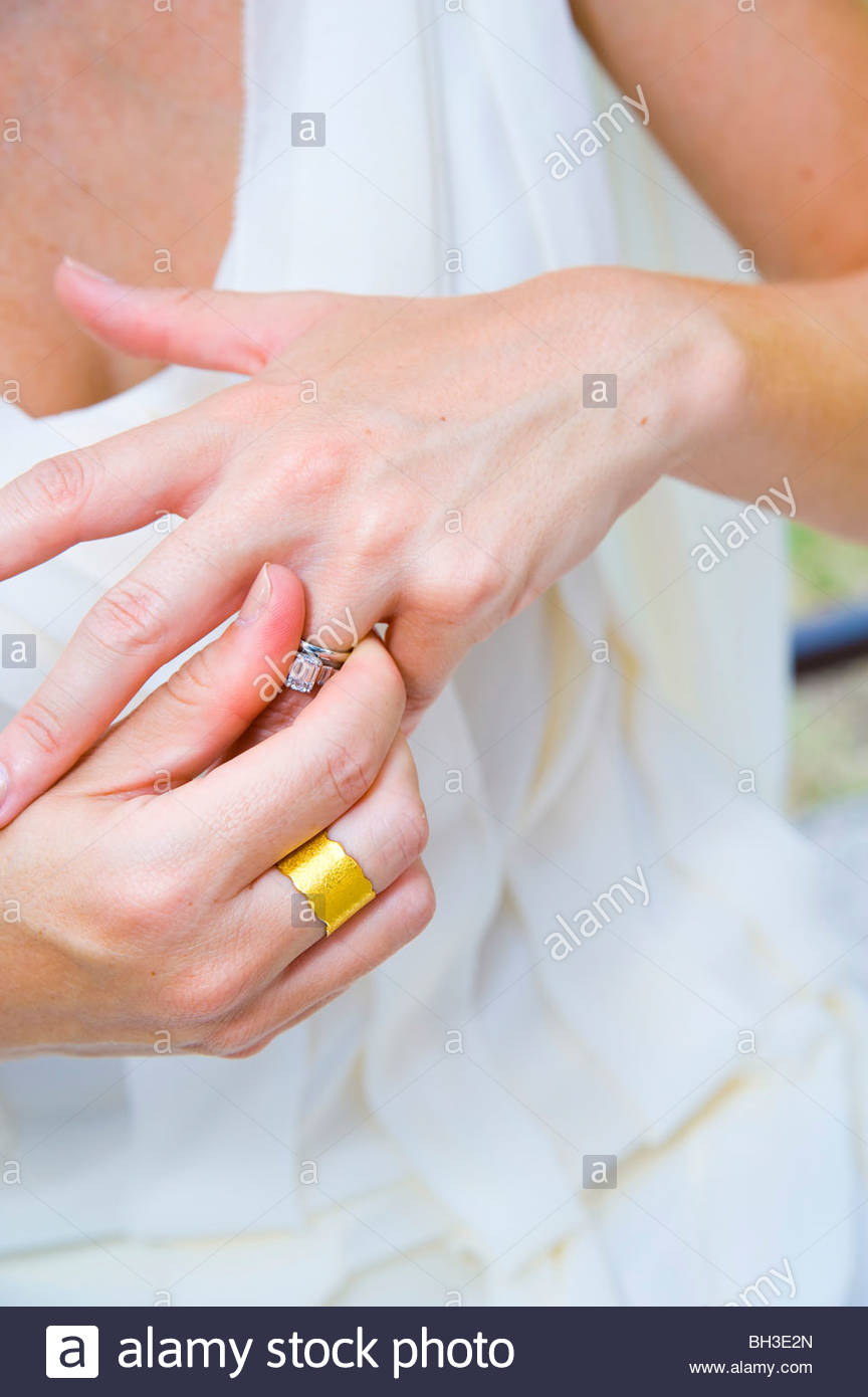 Close-up of bride putting wedding ring on Stock Photo: 27736429 - Alamy