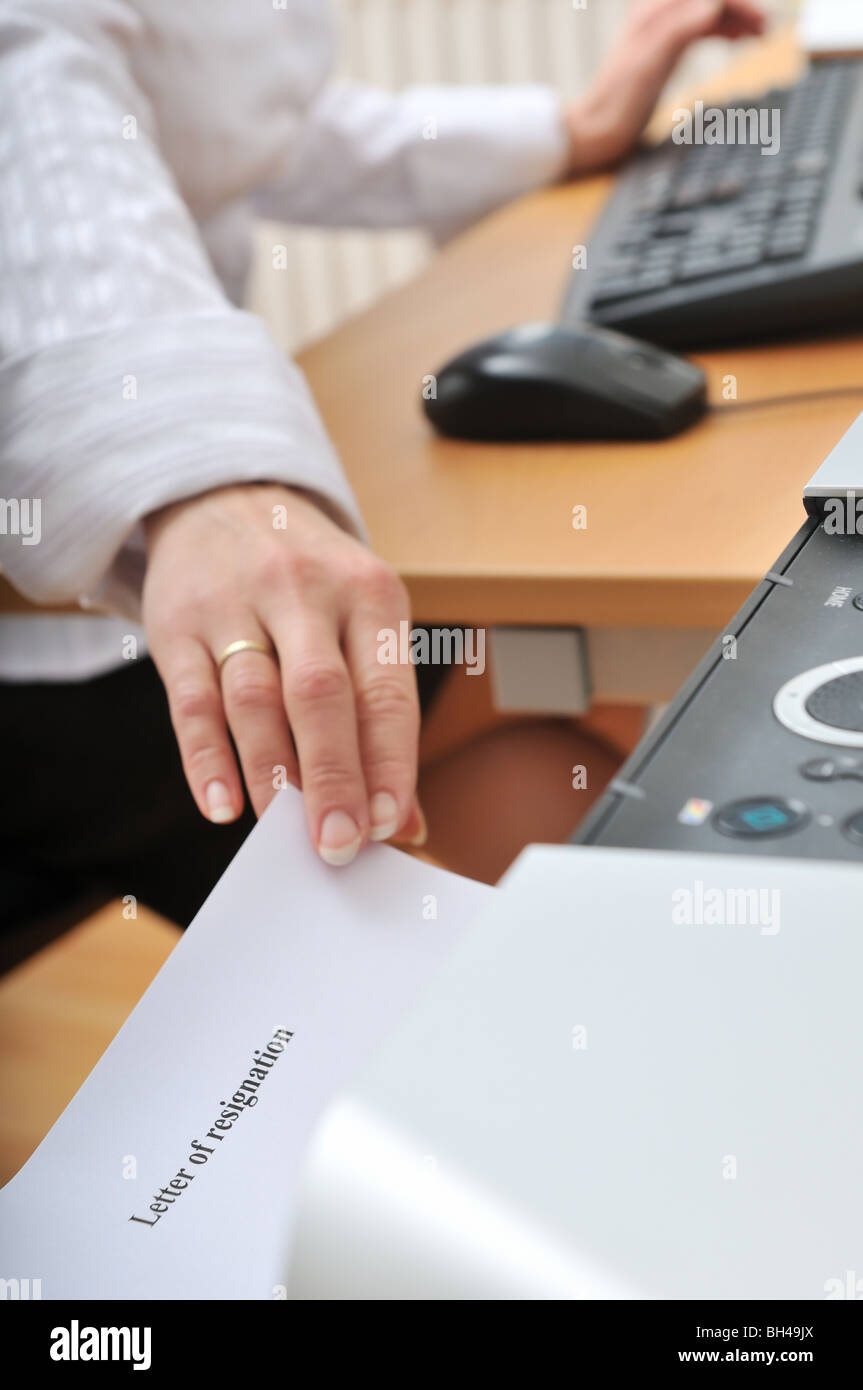 Hand of business woman reching paper letter