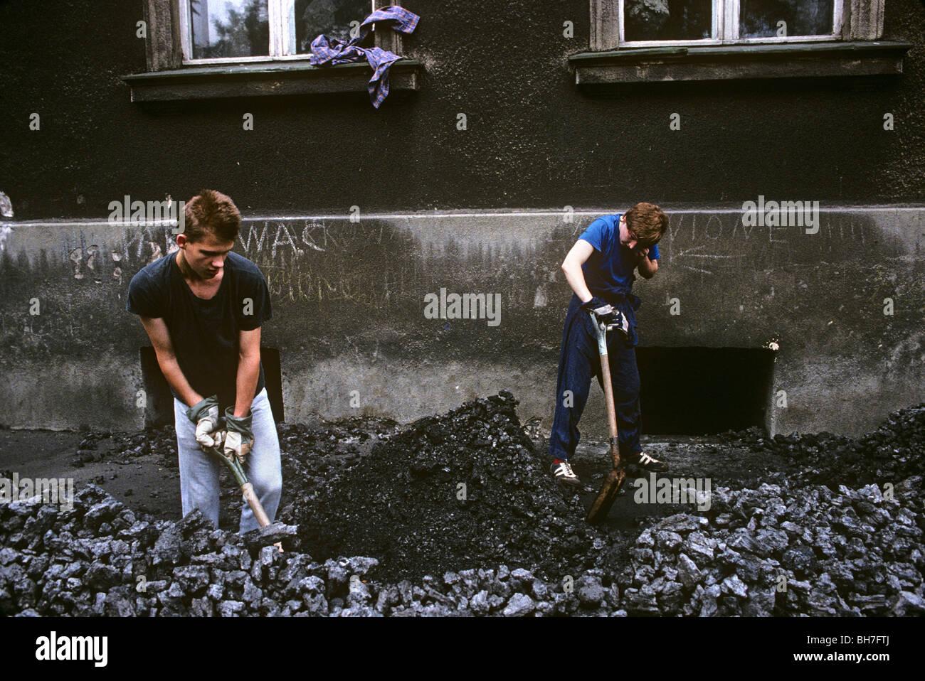 coal-delivery-men-shovel-chunks-of-brown