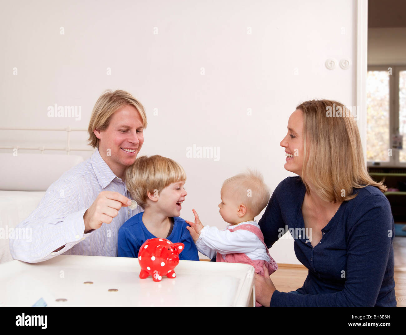 family saving money - Stock Image