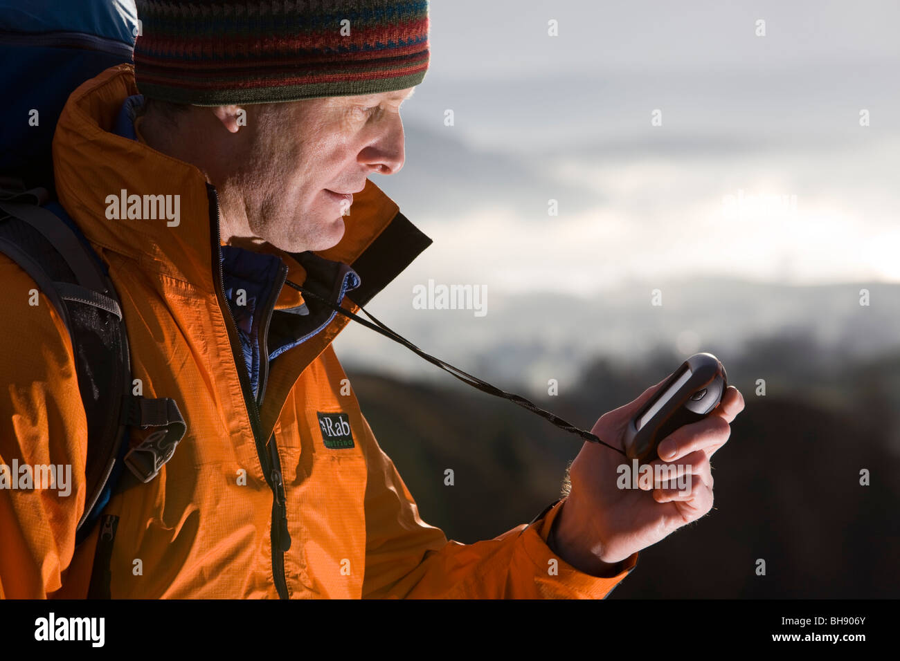 Hiker with GPS unit - Stock Image
