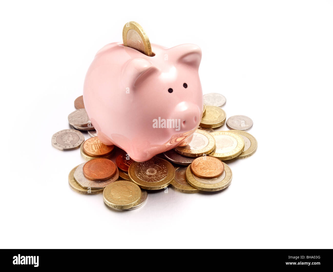 piggy bank on coins of the pound sterling Stock Photo