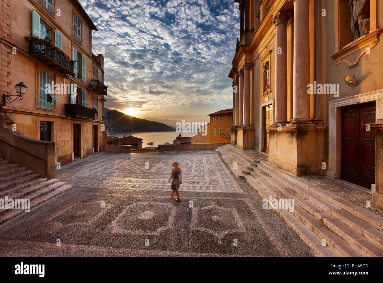 a woman walking through Parvis St Michel at dawn, the Old Town, Menton, Cote d'Azur, Alpes Maritime, Provence, - Stock Image