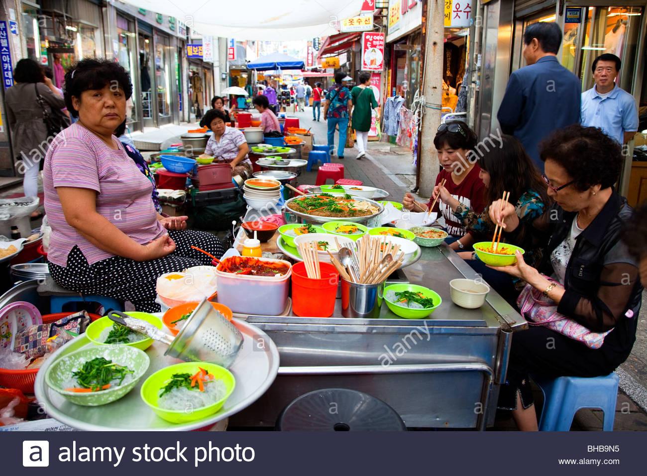 Asia Asian Busan Korean Pusan Republic of South Korea street restaurants tradition traditional woman woman; women; - Stock Image