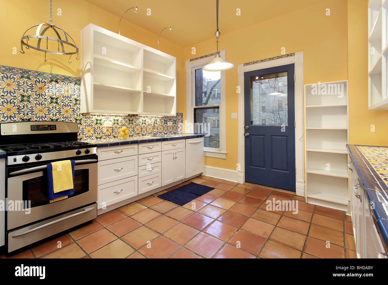 Kitchen in suburban home with terra cotta floor tile and yellow kitchen in suburban home with terra cotta floor tile and yellow walls dailygadgetfo Choice Image