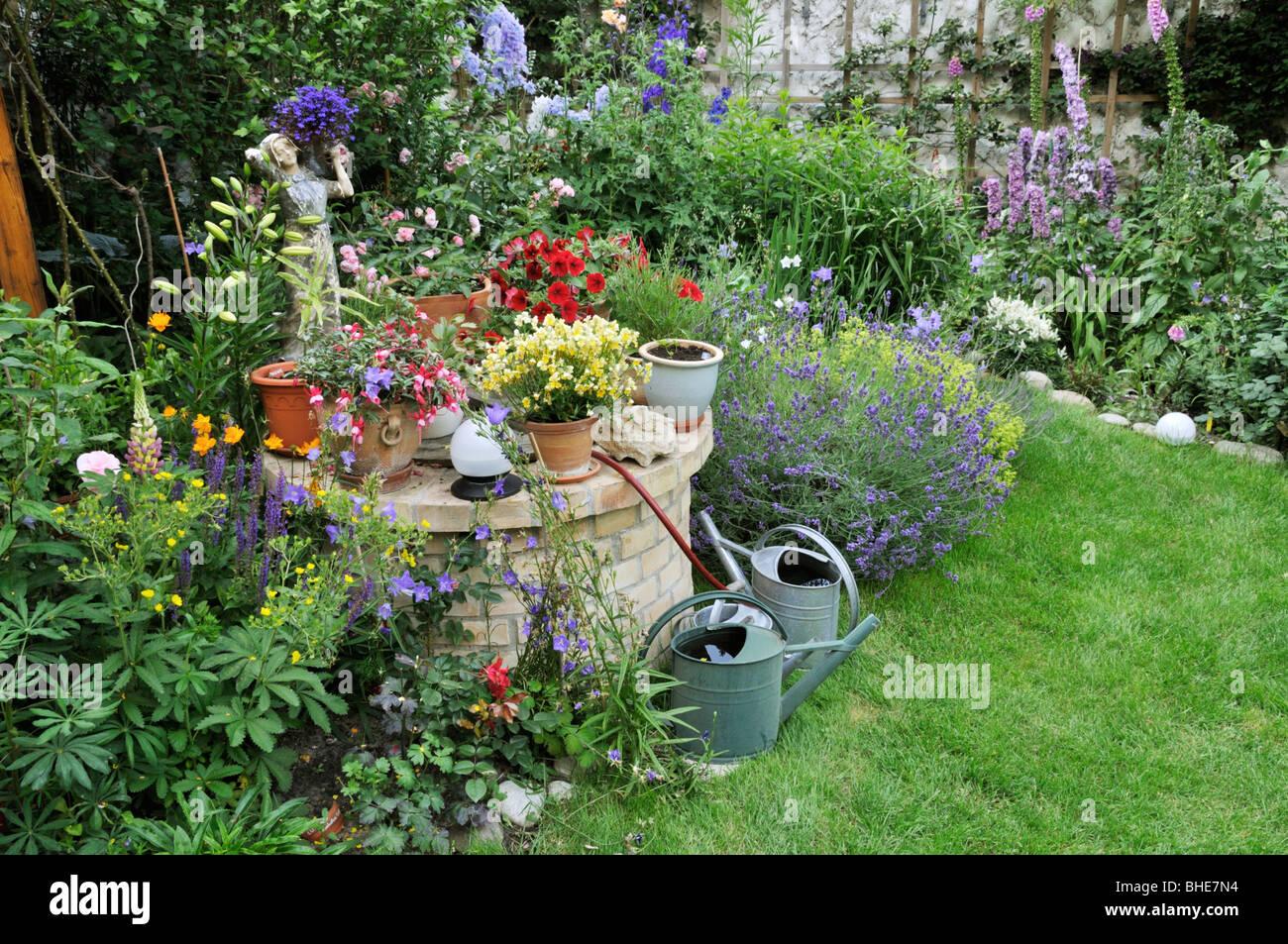 Perennial Bed And Annual Plants In A Backyard Garden Design Jutta