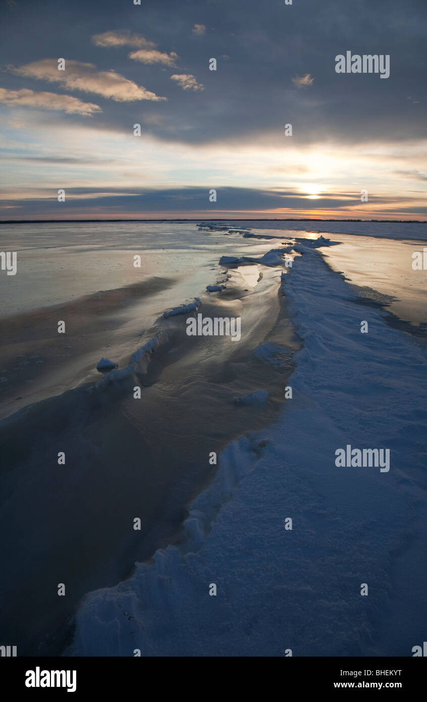 Pressure ridge and a long crack on sea ice at Baltic Sea , Gulf of Bothnia , Finland - Stock Image