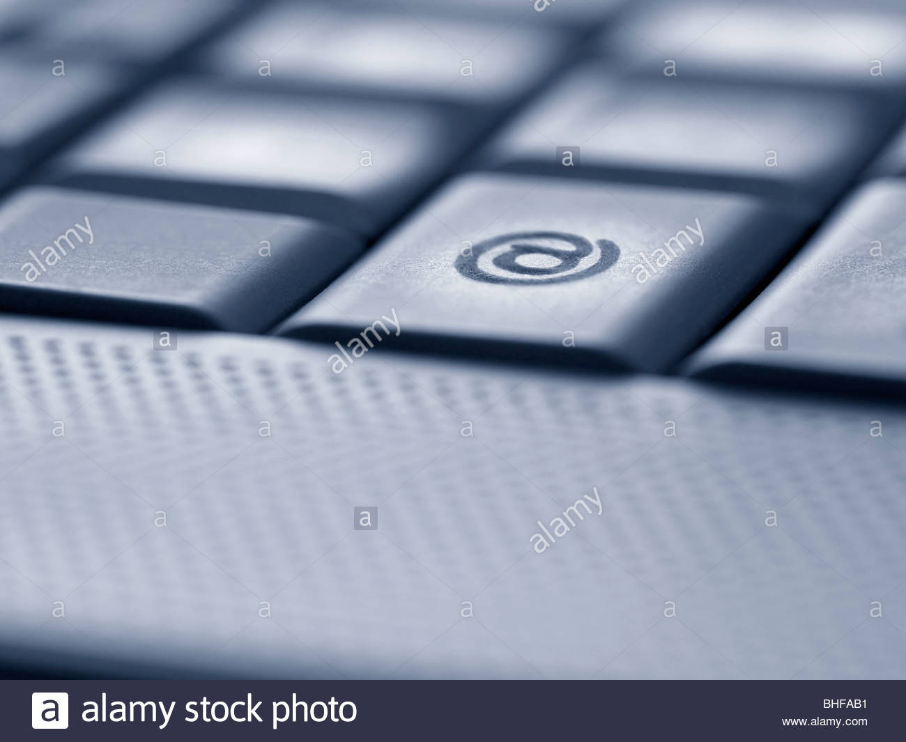 Close Up Of The At Symbol Key On Computer Keyboard Stock Photo