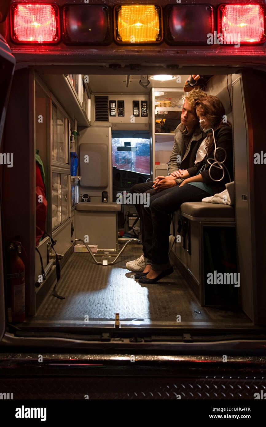 Teenage couple in ambulance - Stock Image