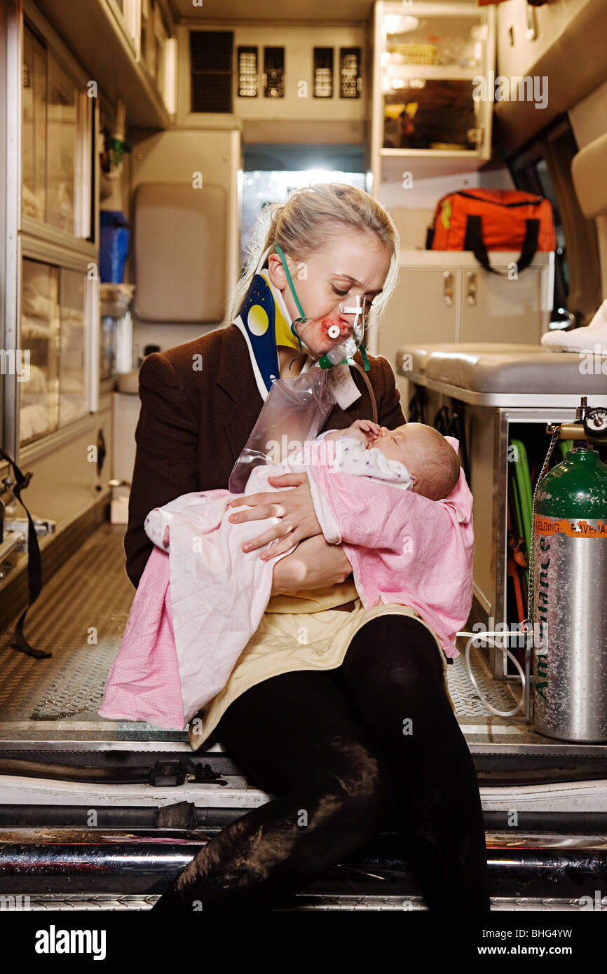 Young woman and baby in ambulance - Stock Image