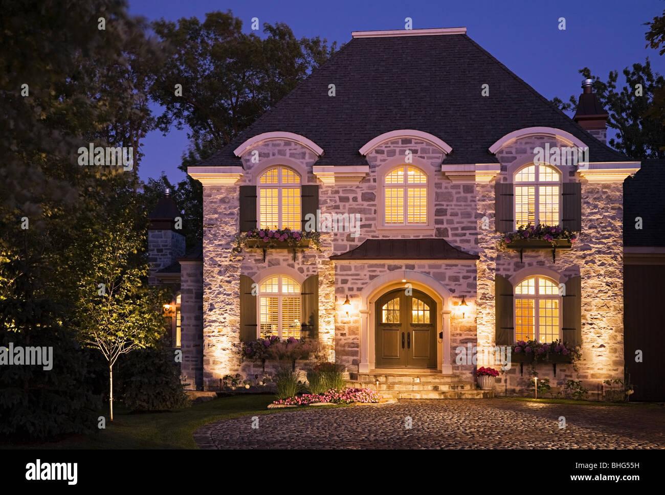 Large house illuminated - Stock Image
